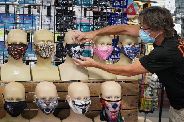 A display of face masks is seen Tuesday at Johnnie Brock's Dungeon Party Warehouse in St. Louis, Mo. Photo by Bill Greenblatt/UPI