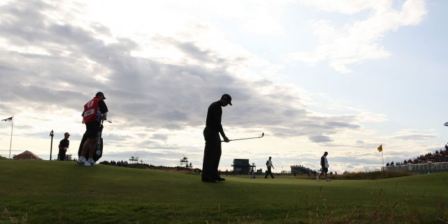 Tiger Woods missed the cut at the British Open after shooting a 4-over-par 74 in the second round Friday.