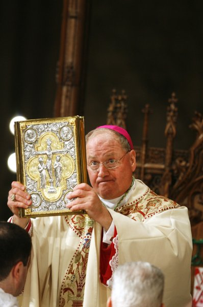 Archbishop Timothy Dolan holds a bible during his Mass of Installation at St. Patrick's Cathedral in New York, April 15, 2009. Dolan, 59, succeeds Cardinal Edward Egan to be the 10th Archbishop of the Archdiocese of New York.The former Milwaukee archbishop is taking over the most visible American job in the Roman Catholic Church and the nation's second-largest diocese after Los Angeles. (UPI Photo/ Lucas Jackson/POOL)