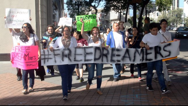 Supporters of the DREAM Act march near a fundraiser for President Barack Obama at the Fox Theater in Oakland, California on July 23, 2012. They joined several hundred protesters of various policies of the Obama administration. UPI/David Yee