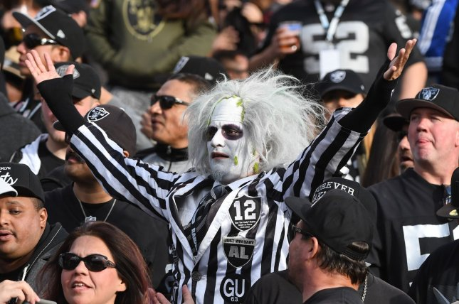 Oakland Raiders fans celebrate a TD against the Carolina Panthers at the Oakland Alameda County Coliseum in Oakland, California on November 27, 2016. The Raiders defeated the Panthers 35-32. File photo by Terry Schmitt/UPI