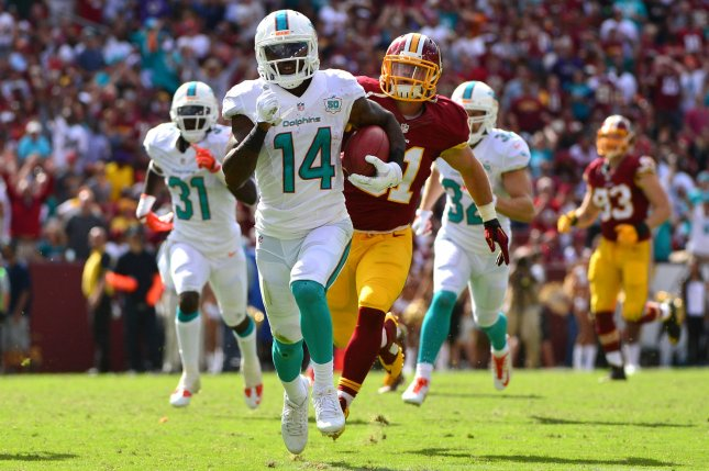 Miami Dolphins receiver Jarvis Landry (14) returns a punt for a 69-yard touchdown against the Washington Redskins in the fourth quarter on September 13, 2015 at FedEx Field in Landover, Maryland. Photo by Kevin Dietsch/UPI