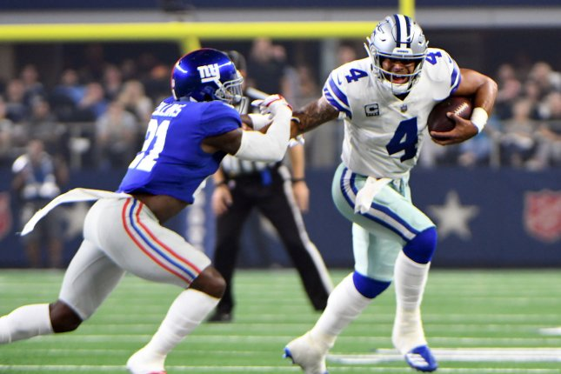 d771b4f7d Dallas Cowboys quarterback Dak Prescott (4) stiff arms New York Giants  safety Landon Collins during the first half on Sunday at AT T Stadium in  Arlington