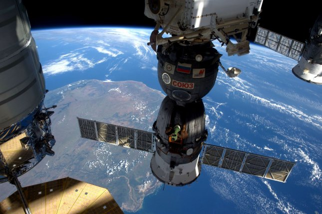 New research reveals that space is unlikely to make bacteria more dangerous to people. Pictured, three of five spacecraft docked with the International Space Station in April 2016 as it flew over Madagascar. Photo by Expedition 47 Flight Engineer Tim Peake/ESA/NASA/UPI