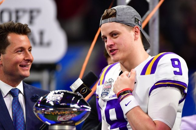 LSU Tigers quarterback and offensive MVP Joe Burrow celebrates after winning the Chick-fil-A Peach Bowl and NCAA semifinal playoff game over the Oklahoma Sooners on Saturday at Mercedes-Benz Stadium in Atlanta. Photo by David Tulis/UPI