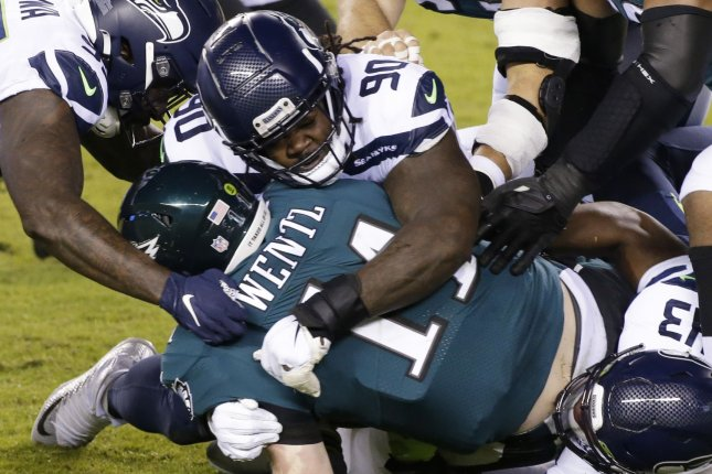 Seattle Seahawks defensive tackle Jarran Reed (90) picks up a half-sack in a win over the Philadelphia Eagles on Monday in Philadelphia. Photo by John Angelillo/UPI