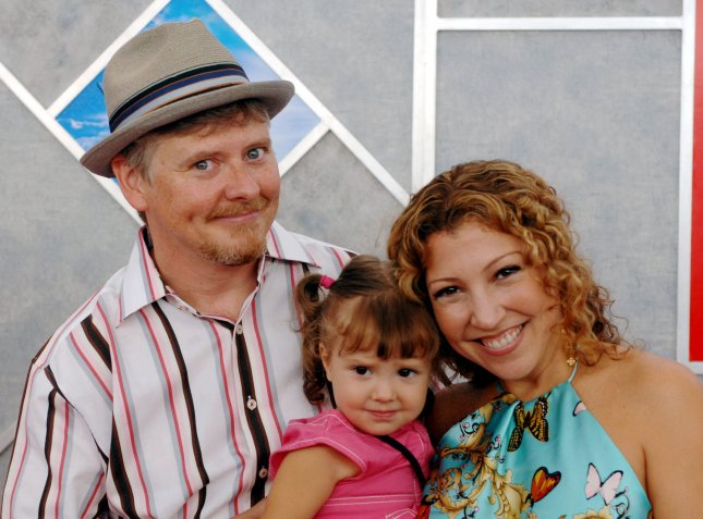 Actor Dave Foley (L), a cast member in the comedy adventure motion picture Sky High, arrives with his wife Crissy and their 2-year-old daughter Alina at the premiere of the film in Los Angeles, California July 24, 2005. The film tells the story of an elite high school, Sky High, entrusted with the responsibility of molding today's power-gifted students into tomorrow's superheroes... (UPI Photo/Jim Ruymen)