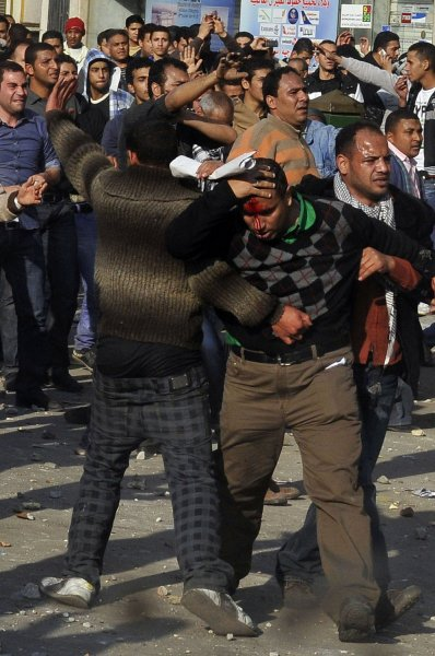 A wounded anti-government protester is escorted to a make-shift medical center during a clash with supporters of Egyptian President Hosni Mubarak in Tahrir Square, Cairo, Feb. 2, 2011. UPI
