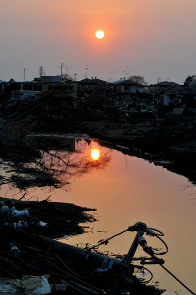 Destruction is seen as the sun goes down in Ishinomaki, Miyagi prefecture, Japan, on April 14, 2011. The area is still recovering from the massive 9.0 earthquake and tsunami last month. UPI/Keizo Mori