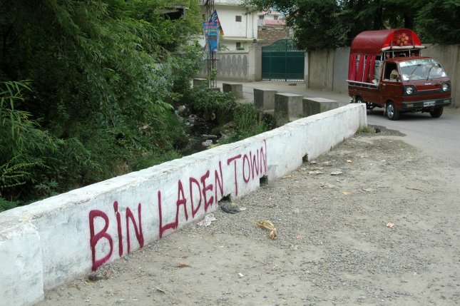 New graffiti reading 'Bin Laden Town' is seen on a wall near the house where al-Qaida leader Osama bin Laden was caught and killed in Abbottabad, Pakistan, on May 6, 2011. The graffiti appeared overnight at various sites around the town. UPI/Sajjad Ali Qureshi