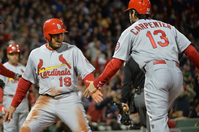 St. Louis Cardinals Jon Jay (19) is congratulated by Matt Carpenter (13), who sacrificed him home, in the seventh inning against the Boston Red Sox in game two of the World Series at Fenway Park in Boston on October 24, 2013. UPI/Kevin Dietsch