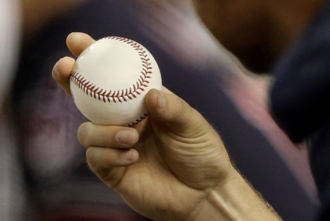 Cleveland Indians pitcher Cody Anderson holds a baseball in the dugout. Photo by John Angelillo/UPI
