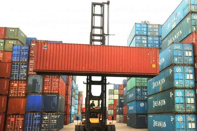 A shipping container is lifted at the Chinese port city of Tianjin. Beijing has announced $3 billion worth of retaliatory tariff measures against the United States, largely affecting agricultural and metal products. File Photo by Stephen Shaver/UPI