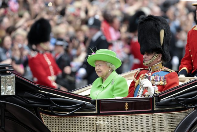 Queen Elizabeth (L), pictured with Prince Philip, marked the opening of the Smith Centre at the Science Museum in London by posting archive photos of a letter on Instagram. File Photo by Hugo Philpott/UPI