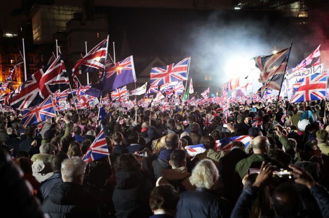 Supporters celebrate Britain's departure from the European Union as it becomes official on Friday in London's Parliament Square. Photo by Hugo Philpott/UPI