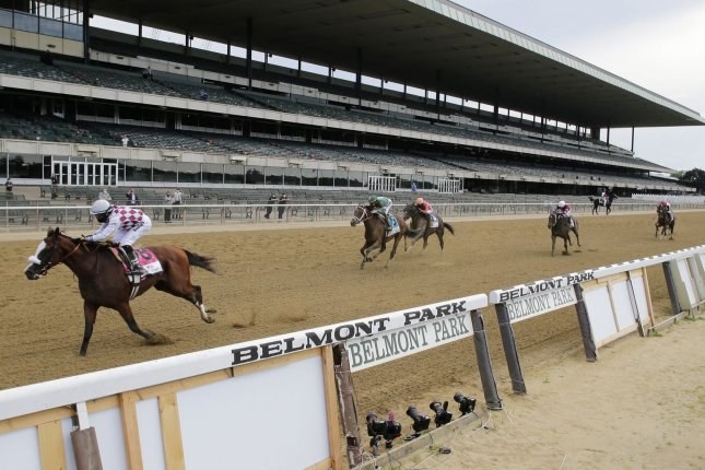 Tiz the Law and jockey Manny Franco win the 152nd running of the Belmont Stakes in Elmont, N.Y., on Saturday with no spectators present because of conornavirus restrictions. Photo by John Angelillo/UPI