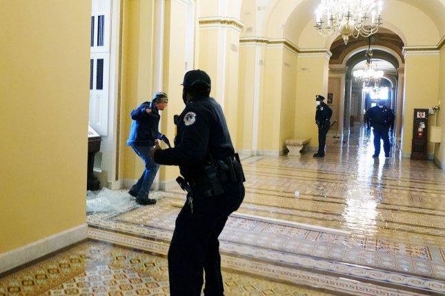 A U.S. Capitol police officer shoots pepper spray at a radical pro-Trump rioter inside the U.S. Capitol building onJanuary 6 during a joint session of Congress in Washington, D.C., to certify President Joe Biden's electoral victory. Photo by Kevin Dietsch/UPI