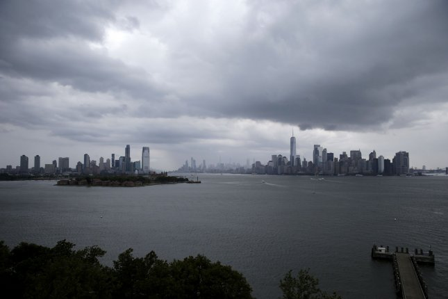 Storm clouds pass over One World Trade Center and the Manhattan skyline on Thursday in New York City. Photo by John Angelillo/UPI