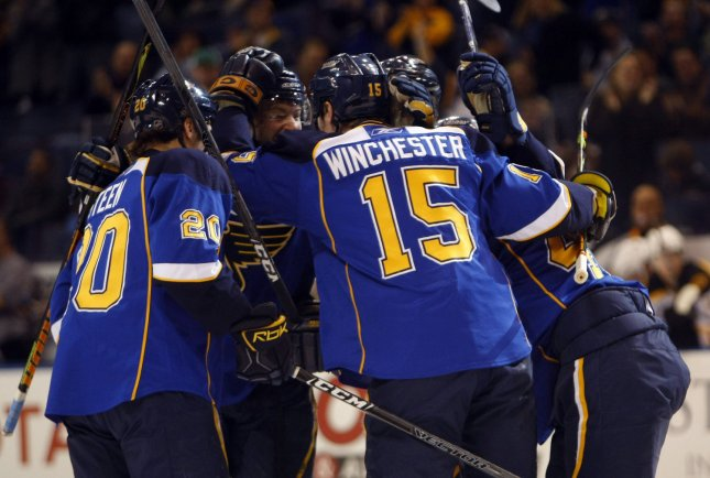 St. Louis Blues Brad Winchester (15) is congratulated by teammates after scoring a goal against the Boston Bruins in the first period at the Scottrade Center in St. Louis on December 21, 2008. (UPI Photo/Bill Greenblatt)