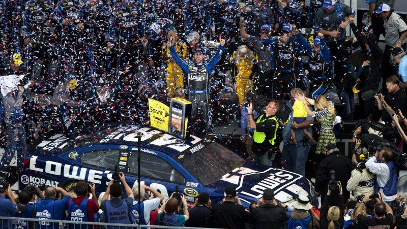 Jimmie Johnson celebrates in Gatorade Victory Lane after winning the 55th Daytona 500 auto race at Daytona International Speedway in Daytona Beach, Florida February 24, 2013. UPI/Dave Ferrell