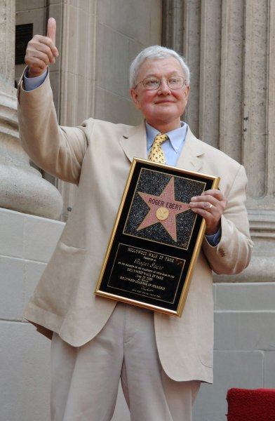Film critic Roger Ebert gestures with a thumbs up during a Hollywood Walk of Fame ceremony honoring Ebert with the 2,288th star on the famous walkway in Los Angeles June 23, 2005..(UPI Photo/Jim Ruymen)