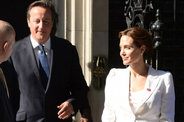 American actress Angelina Jolie and British Prime Minister David Cameron attend a meeting on the opening day of the global conference on preventing sexual violence in conflict at No 10 Downing Street in London on June 10, 2014. UPI/ Rune Hellestad