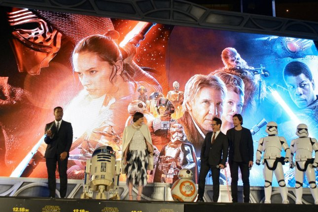 Researchers in Australia said little research has been done on the effects of movie scores, rather than pop music, on doctors while performing procedures. They chose Star Wars because of the upcoming release of Star Wars: Episode VII The Force Awakens. Above, actor John Boyega, actress Daisy Ridley, director J.J. Abrams, and actor Adam Driver attend the Japanese premiere for Episode VII. File photo by Keizo Mori/UPI
