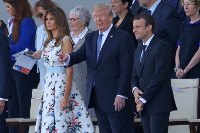 First Lady Melania Trump (L) with President Donald Trump (C) and French president Emmanuel Macron at a Bastille Day parade in Paris on Friday. Photo by David Silpa/UPI