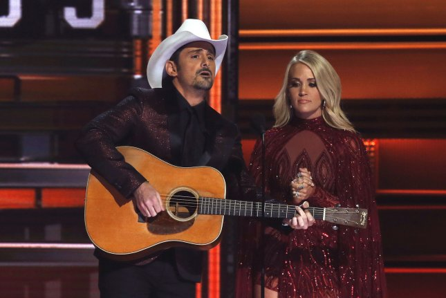 Carrie Underwood (R) and Brad Paisley host the 51st Annual Country Music Association Awards on Wednesday. The pair opened the show with a monologue that addressed the past year's events. Photo by John Sommers II/UPI