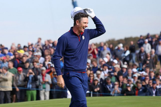 Justin Rose celebrates after his shot won the 12th hole for Team Europe on day one of the Ryder Cup on Friday at Le Golf National in Guyancourt near Paris. Photo by David Silpa/UPI