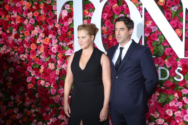 Comedian Amy Schumer and her husband, chef Chris Fischer, are set to star in upcoming Food Network series Amy Schumer Learns to Cook, the cable network said. File Photo by Serena Xu-Ning/UPI