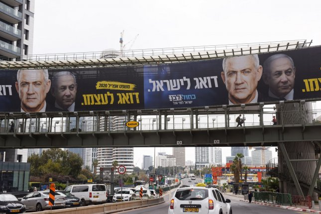 An election campaign advertisement for Blue and White Party leader Benny Gantz, with Prime Minister Benjamin Netanyahu in the background, is seen on a pedestrian bridge in Ramat Gan, Israel, on February 23. File Photo by Debbie Hill/UPI