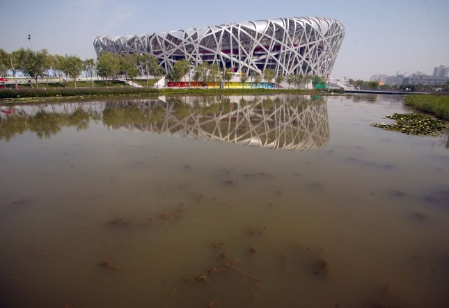 Pond scum and algae pollute a lake adjacent to the Olympic National Stadium, or Bird's Nest in Beijing. Exxon estimates that algae could yield 2,000 gallons of fuel per acre each year. (UPI Photo/Stephen Shaver)