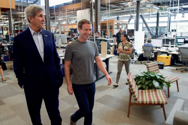 Facebook reported a huge third quarter -- $7.01 billion in revenue and 1.79 billion users -- but warned ad load on the company's website and apps is nearing capacity and revenue growth may not grow as fast in the near future. Facebook CEO Mark Zuckerberg, pictured while U.S. Secretary of State John Kerry a tour of Facebook's new headquarters in Menlo Park, Calif., said the company is finding new services and ways to grow its user base in order to continue growing the number of it can sell and deliver. File photo by U.S. Department of State/UPI