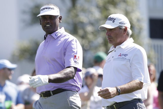 Vijay Singh (L) and Freddie Couples (R) play a practice round together on Tuesday at the 2017 Masters Tournament at Augusta National Golf Club in Augusta, Georgia on April 4, 2017. File photo by John Angelillo/UPI