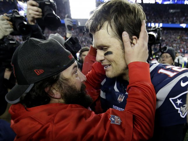 Former New England Patriots defensive coordinator Matt Patricia and current Detroit Lions head coach Matt Patricia hugs quarterback Tom Brady after a win in the AFC Championship game over the Jacksonville Jaguars in January. Photo by John Angelillo/ UPI
