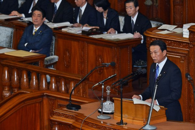 Taro Aso (R), Japan's deputy prime minister and finance minister, is not ruling out claims of sexual harassment against a subordinate in the finance ministry. File Photo by Keizo Mori/UPI