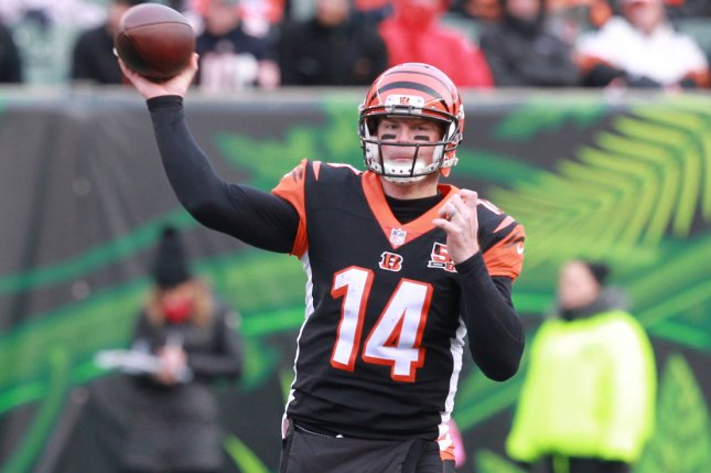 Cincinnati Bengals quarterback Andy Dalton (14) throws under pressure from the Chicago Bears' defense during the second half of play on December 10 at Paul Brown Stadium in Cincinnati. File photo by John Sommers II/UPI