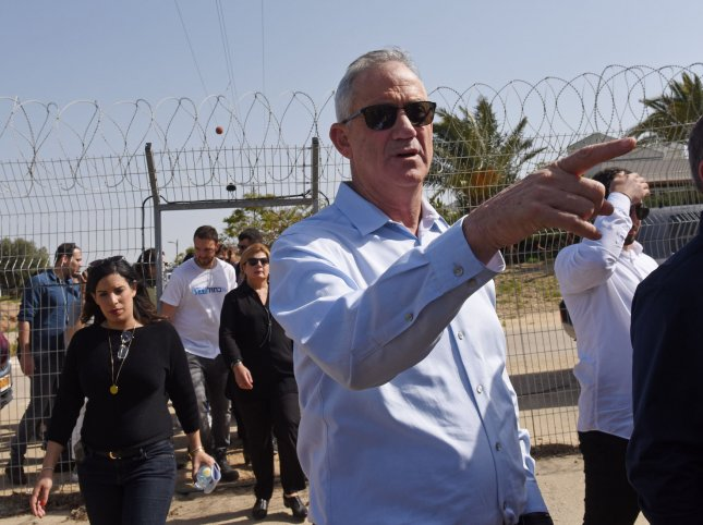 Benny Gantz, leader of the new Israeli Blue and White Party, points to Gaza in the distance, after crossing inside the security fence in Kfar Aza on the Israeli-Gaza border in southern Israel. Photo by Debbie Hill/UPI