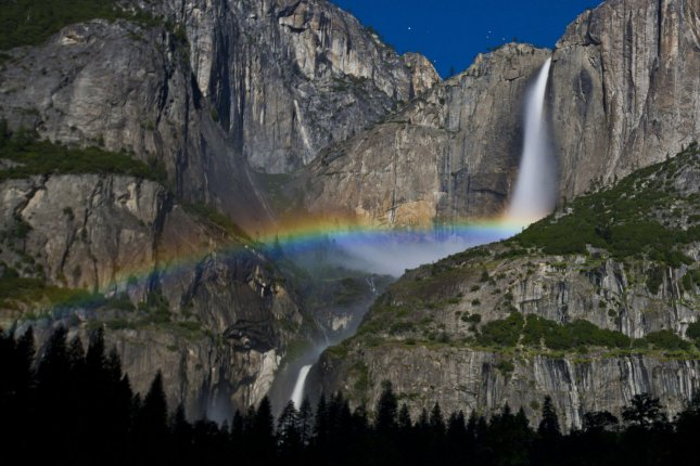 A rainbow over Yosemite Falls in Yosemite National Park. A new independent report recommends that the U.S. conserve 30 percent of all U.S. land mass by 2030 to avert the damages of climate change and save 12,000 endangered wildlife species. File photo by Terry Schmitt/UPI.