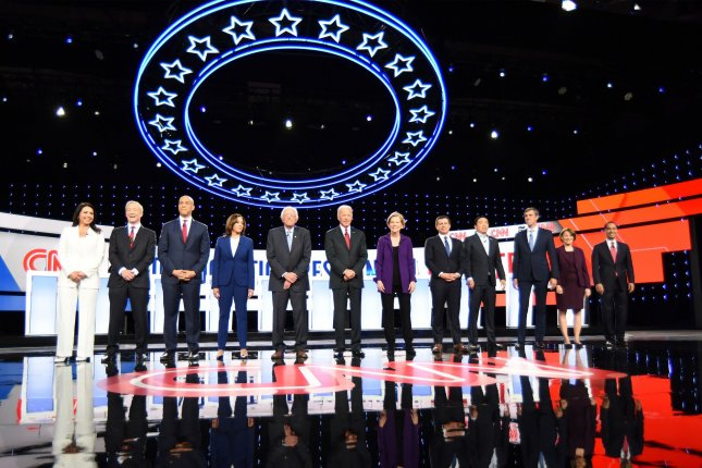 Democratic presidential candidates take the stage prior to the debate Tuesday on the campus of Otterbein University in Westerville, Ohio. Photo by Robert Moorhead/UPI