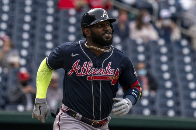 Atlanta Braves left fielder Marcell Ozuna runs to first base against the Washington Nationals in the first inning at Nationals Park in Washington, D.C. on May 6. Last Tuesday, he fractured two left fingers and Friday was placed on the injured list. Photo by Tasos Katopodis/UPI