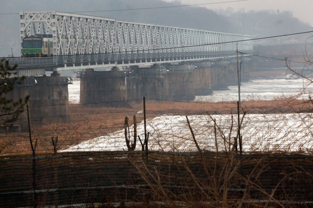 A barbed wire fence guards the Freedom Bridge, connecting South Korea to the Demilitarized Zone (DMZ) and North Korea as a train crosses it from Seoul in 2013. North Korea is seeking to attract foreign capital through special economic zones, a 6,000-page North Korean document revealed. File Photo by Stephen Shaver/UPI