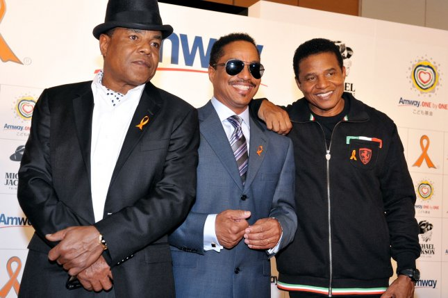 (L-R) Tito Jackson, Marlon Jackson and Jackie Jackson attend an Amway Japan charity event in Tokyo on Dec. 12, 2011. Photo by Keizo Mori/UPI