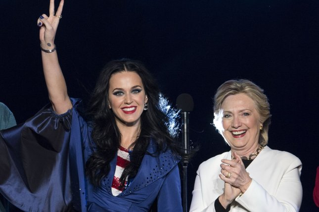 Hillary Clinton (R) holds a rally with singer-songwriter Katy Perry in Philadelphia on November 5. Clinton presented Perry with the Audrey Hepburn Humanitarian Award at UNICEF's Snowflake Ball on Tuesday. File Photo by Kevin Dietsch/UPI