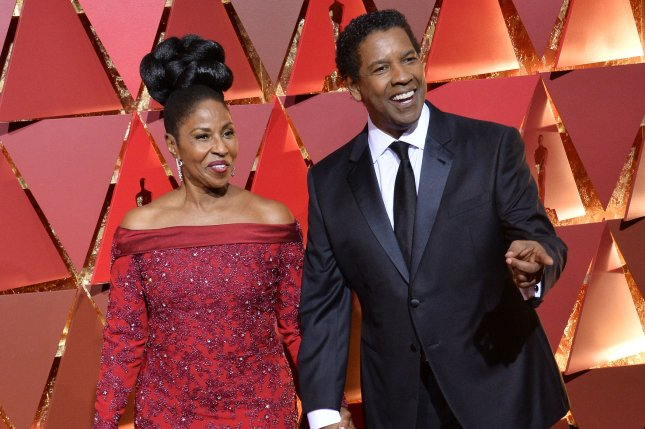 Pauletta and Denzel Washington arrive on the red carpet for the 89th annual Academy Awards at the Dolby Theatre in the Hollywood section of Los Angeles on February 26. Photo by Jim Ruymen/UPI