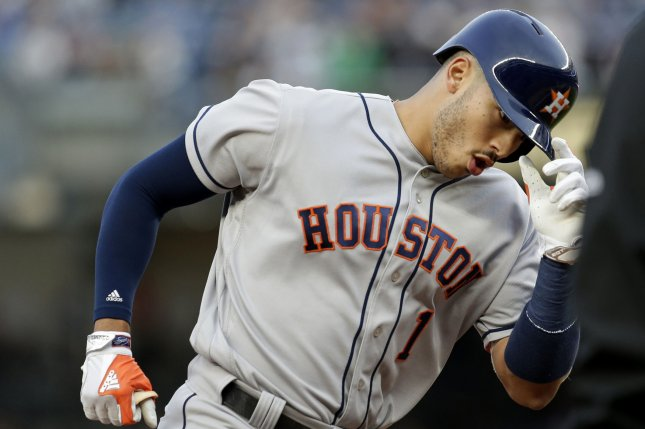 Houston Astros' Carlos Correa reacts as he rounds 3rd base after hitting a home run. File photo by John Angelillo/UPI