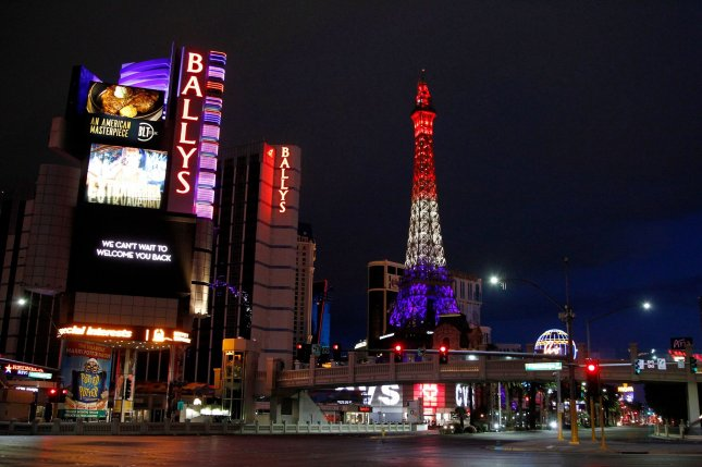 A red, white and blue illuminated Eiffel Tower at the Paris Hotel and Casino looms over an empty Las Vegas Strip, which has been shut down due to the coronavirus.  Photo by James Atoa/UPI