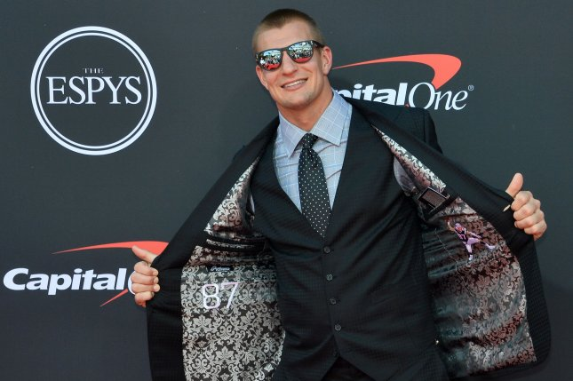 NFL player Rob Gronkowski was revealed as the White Tiger and eliminated from The Masked Singer on Wednesday night. File Photo by Jim Ruymen/UPI