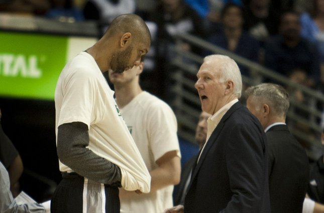Former San Antonio Spurs star Tim Duncan (L), who was a 15-time All-Star selection, spent his entire 19-year playing career with the Spurs. File Photo by Gary C. Caskey/UPI